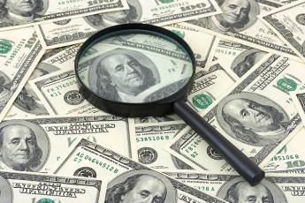 عکس دلار و ذره بین